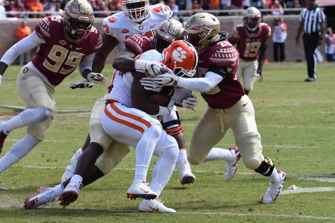 FSU redshirt freshman linebacker DeCalon Brooks (28) stopping the Clemson running back in the second quarter of FSU's game against Clemson on Oct. 27 at Doak Campbell Stadium.