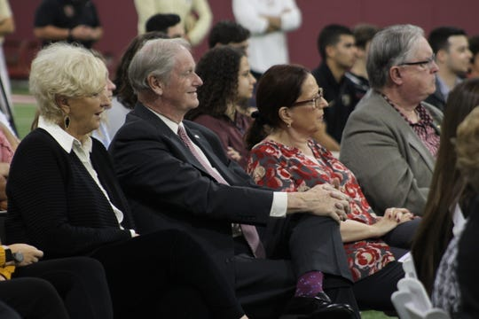 President John Thrasher and his wife Jean watch Albert and Judy Dunlap speak about their relationship with FSU at the Seminole Student Boosters event.