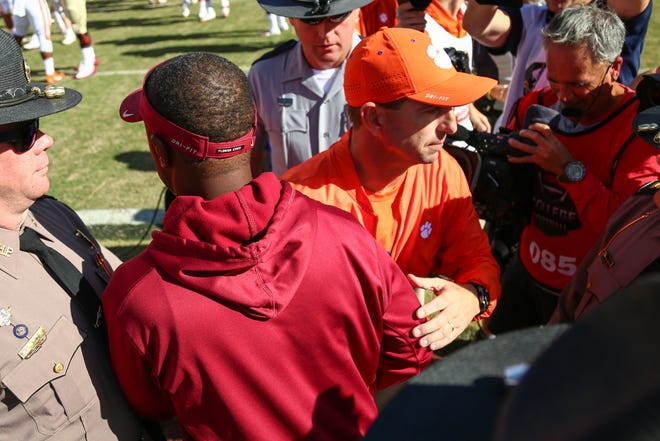 Coaches Willie Taggart (FSU) and Dabo Swinney (Clemson) briefly shake hands after FSU's horrendous loss to Clemson 59-10 on Saturday, October 27th.