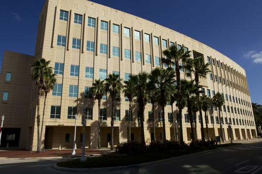 Trial of three suspects accused of conspiring to loot Lee County of economic development fund through VR Laboratories, a failed nutrition drink company, will be tried at the federal courthouse in Fort Myers.