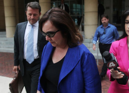Former Lee County Commissioner Tammy Hall leaves the federal courthouse after pleading  guilty to wire fraud during a brief hearing this afternoon.  On the left is her attorney Eric Padron.