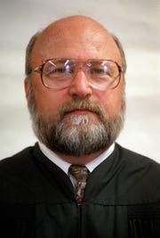United States District Judge John Steele is presiding in the trial of three suspects being tried for allegedly defrauding Lee County of millions.