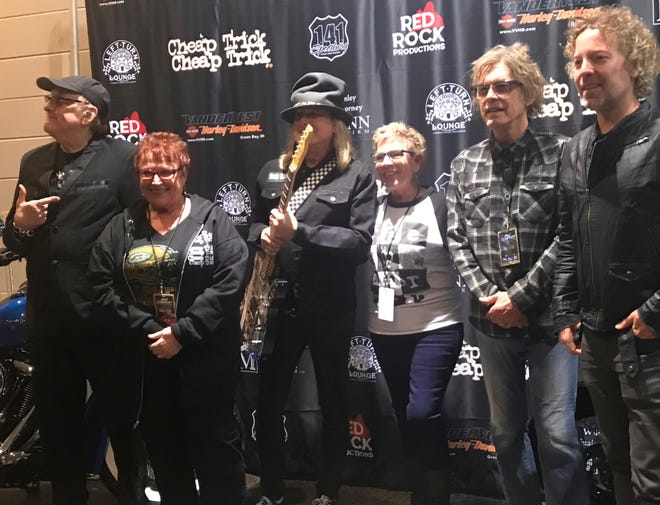 Thirty years after she was to meet Cheap Trick at Brown County Veterans Memorial Arena, Roxann Nys of Green Bay, second from left, finally got her backstage moment on Saturday night at the Resch Center. Pictured, from left, is Rick Nielsen, Nys, Robin Zander, Pam Bass (Nys' friend), Tom Petersson and Daxx Nielsen.