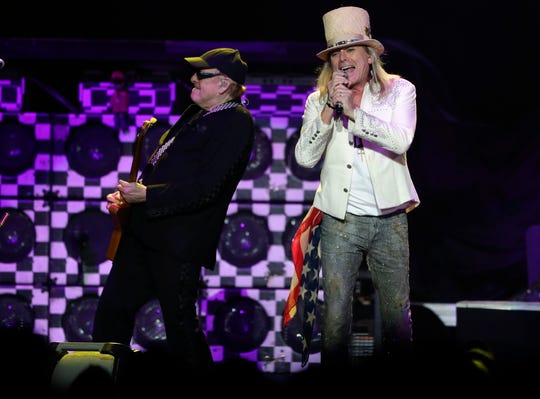 Cheap Trick's Rick Nielsen, left, and Robin Zander perform Saturday night at the Resch Center.