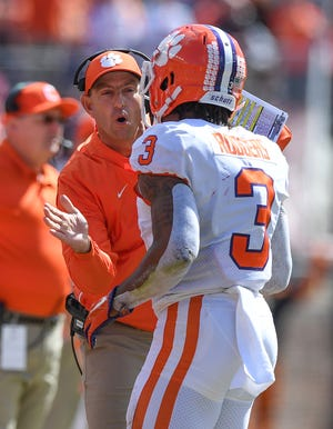 Clemson head coach Dabo Swinney coaches wide receiver Amari Rodgers (3) during the 2nd quarter Saturday, October 27, 2018 at Florida State's Doak Campbell Stadium in Tallahassee, Fl.