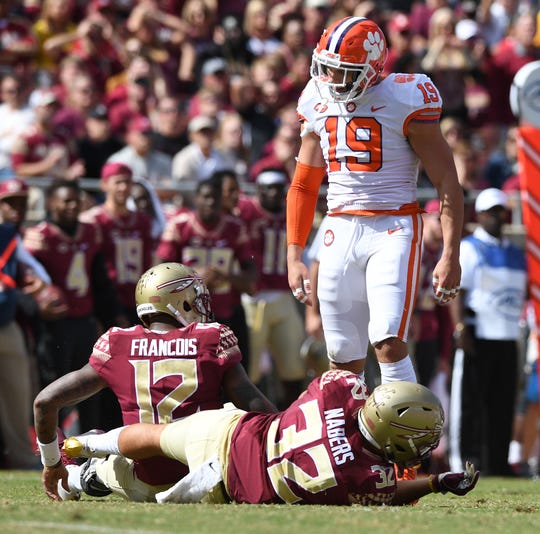 Clemson defensive back Tanner Muse (19) stands over Florida State quarterback Deondre Francois (12) after a defensive stop during the 1st quarter Saturday, October 27, 2018 at Florida State's Doak Campbell Stadium in Tallahassee, Fl.