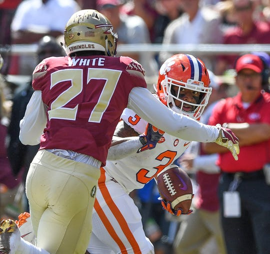 Clemson wide receiver Amari Rodgers (3) tries to elude Florida State wide receiver Ontaria Wilson (27) during the 2nd quarter Saturday, October 27, 2018 at Florida State's Doak Campbell Stadium in Tallahassee, Fl.