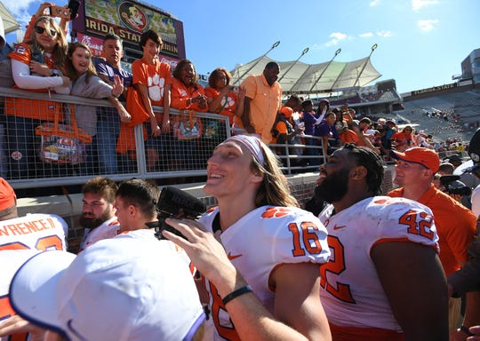 Clemson quarterback Trevor Lawrence (16) and defensive lineman Christian Wilkins (42) after the Tiger 59-10 win over Florida State during the 4th quarter at Florida State's Doak Campbell Stadium in Tallahassee, Fl, Saturday, October 27, 2018