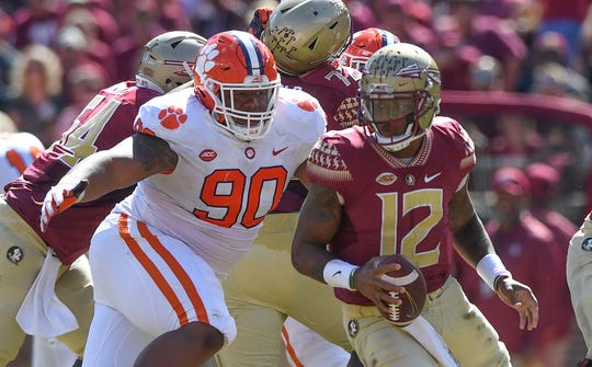 Clemson defensive lineman Dexter Lawrence (90) bears down on Florida State quarterback Deondre Francois (12) during the 2nd quarter Saturday, October 27, 2018 at Florida State's Doak Campbell Stadium in Tallahassee, Fl.