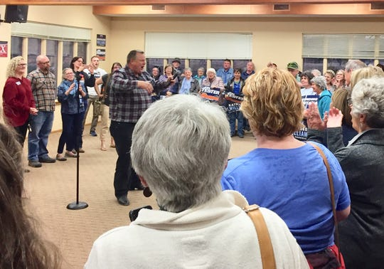 Sen. Jon Tester leads the crowd in cheers Saturday at a rally in Great Falls for Democratic candidates.