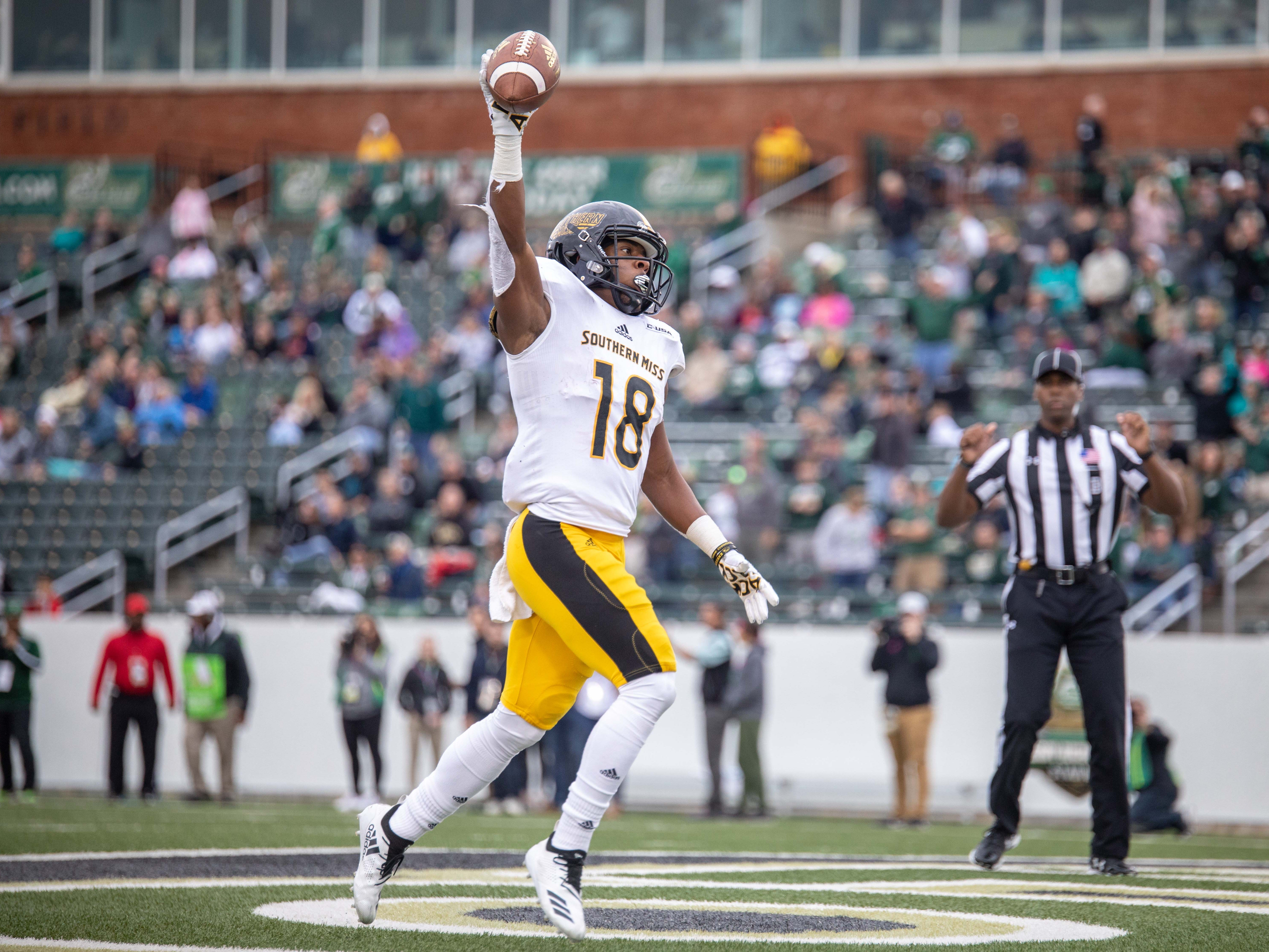 Southern Miss wide receiver De'Michael Harris (18) celebrates a 43-yard touchdown pass Saturday in Charlotte, N.C.