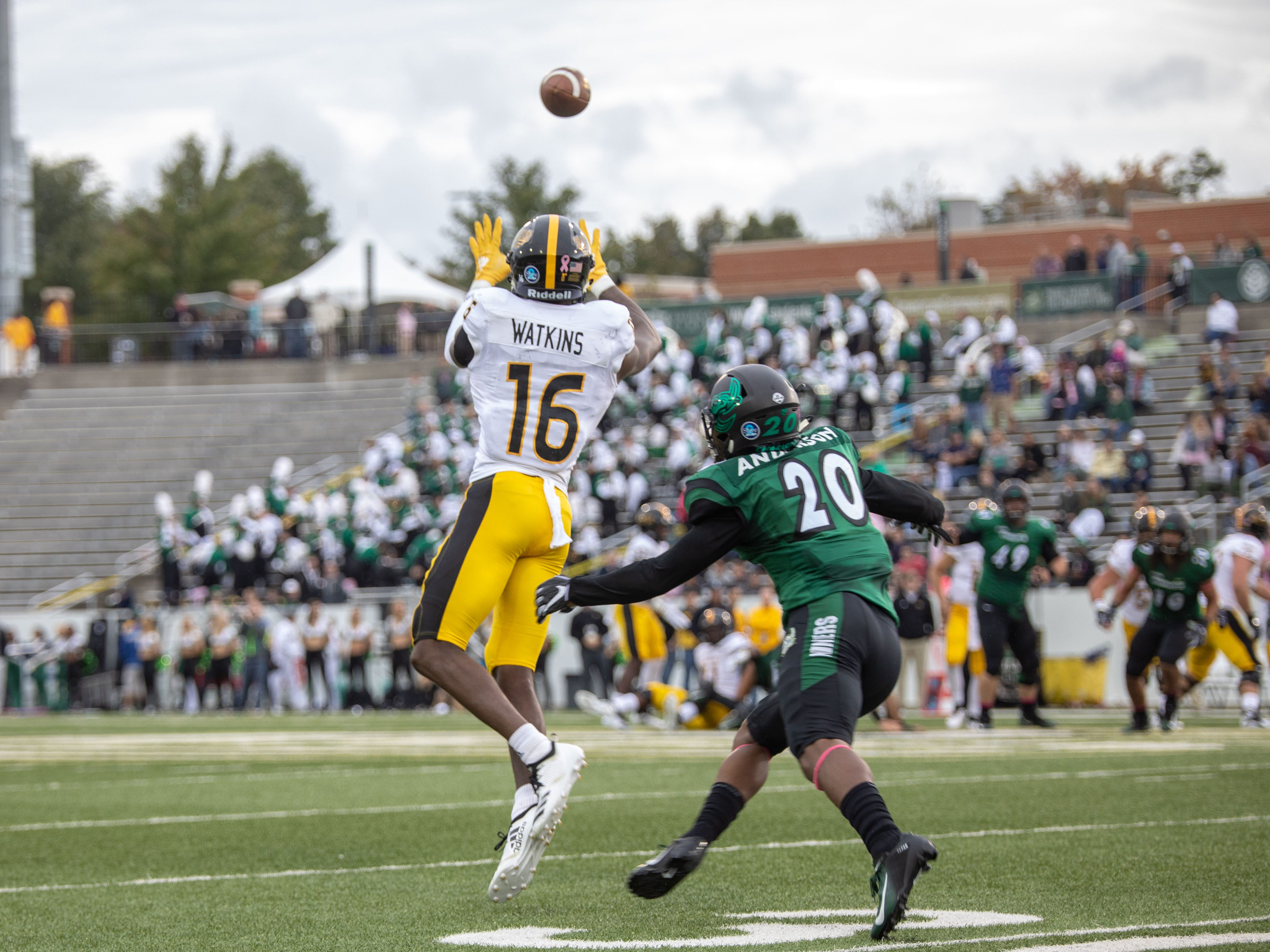 Southern Miss receiver Quez Watkins (16) prepares to haul in a pass as Charlotte defender D.J. Anderson closes Saturday in Charlotte, N.C.