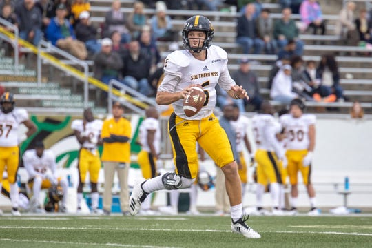 Southern Miss quarterback Tate Whatley (6) rolls out as he looks for a receiver Saturday in Charlotte, N.C.