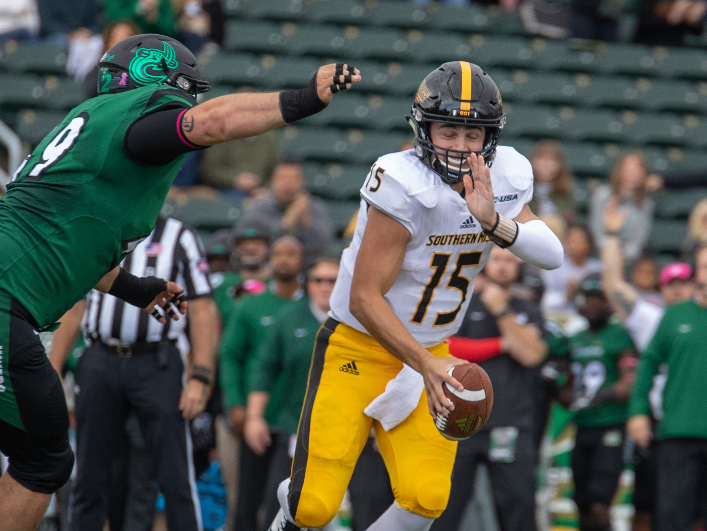 Southern Miss quarterback Jack Abraham (15) avoids the pressure from Charlotte defensive lineman Tyler Fain Saturday in Charlotte, N.C.