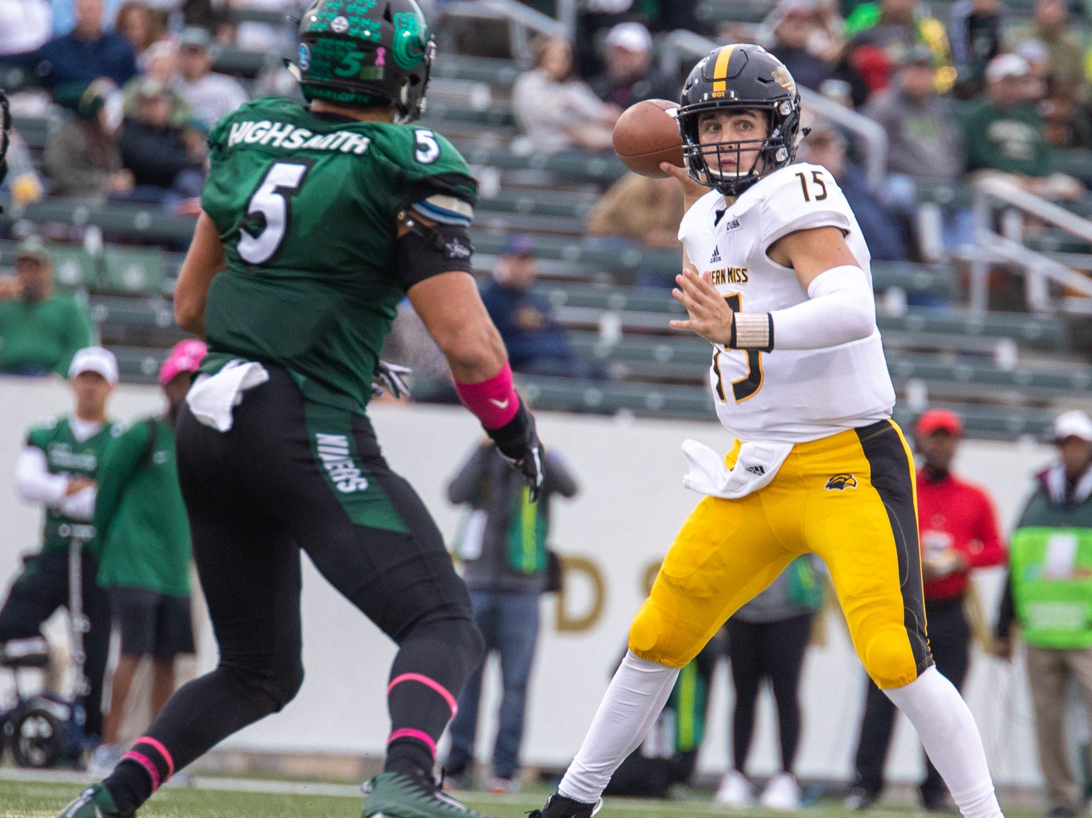 Southern Miss quarterback Jack Abraham (15) prepares to throw a pass as Charlotte defensive end Alex Highsmith applies pressure Saturday in Charlotte, N.C.