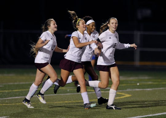 Henderson County players celebrate Maddie Griggs' goal against Bethlehem in the KHSAA state quarterfinals at Paul Laurence Dunbar in Lexington, Ky., Saturday night.