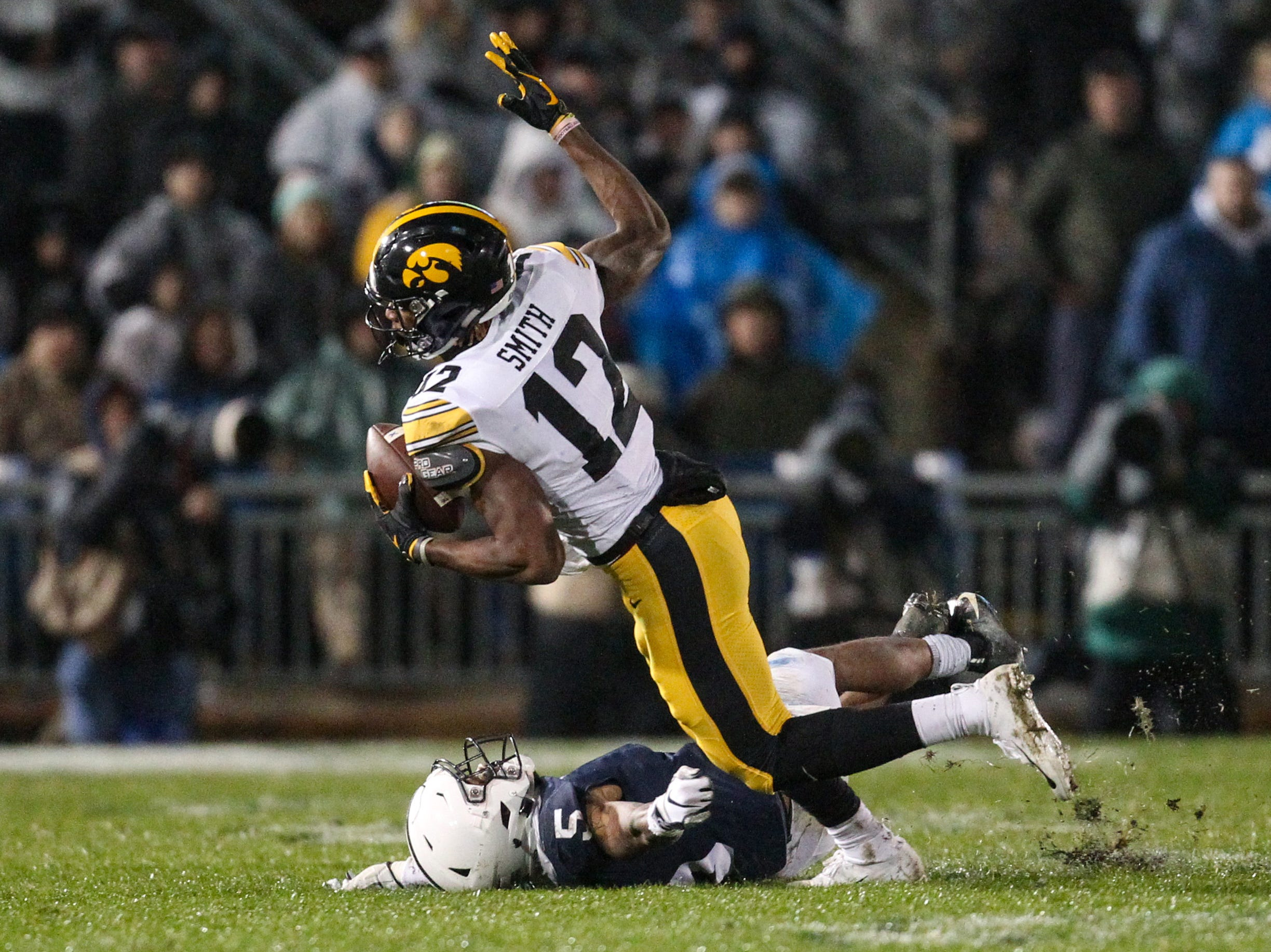 Oct 27, 2018; University Park, PA, USA; Iowa Hawkeyes wide receiver Brandon Smith (12) runs with the ball during the fourth quarter against the Penn State Nittany Lions at Beaver Stadium. Penn State defeated Iowa 30-24. Mandatory Credit: Matthew O'Haren-USA TODAY Sports