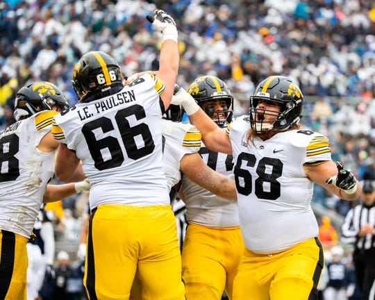 Levi (66) and Landan (68) Paulsen celebrate a fake-field goal touchdown at Penn State earlier this season. The twin brothers will be fifth-year seniors in 2019 with a shot to be starters.