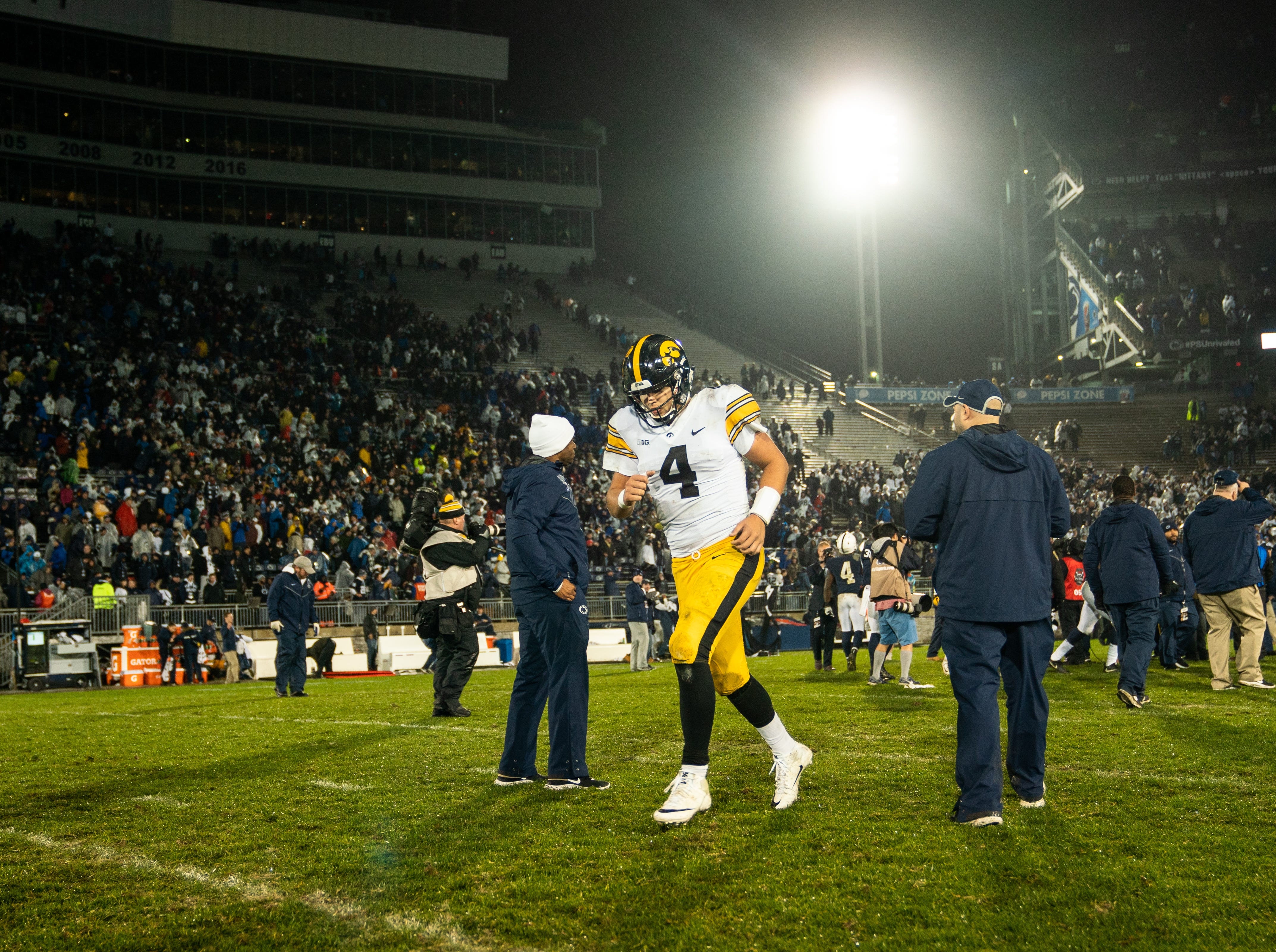 Nate Stanley #4 of the Iowa Hawkeyes walks off the field after a 30-24 to the Penn State Nittany Lions at Beaver Stadium on Saturday, October 27, 2018, in State College, Pennsylvania.
