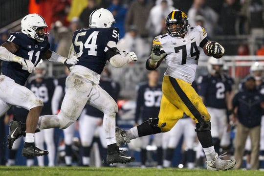 Oct 27, 2018; University Park, PA, USA; Iowa Hawkeyes offensive linesmen Tristan Wirfs (74) runs with the ball during the fourth quarter against the Penn State Nittany Lions at Beaver Stadium. Penn State defeated Iowa 30-24. Mandatory Credit: Matthew O'Haren-USA TODAY Sports