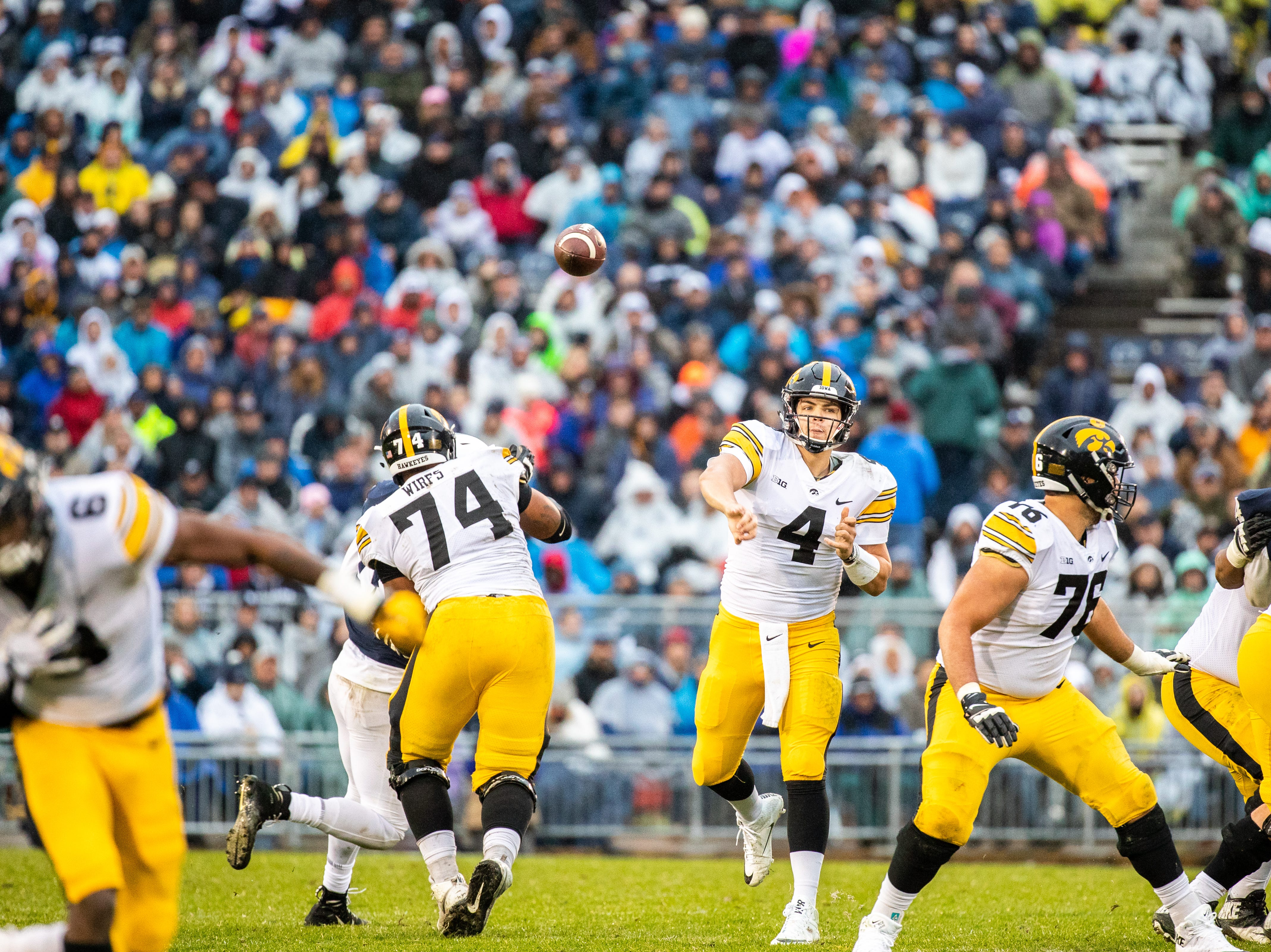 Nate Stanley #4 of the Iowa Hawkeyes throws a pass against the Penn State Nittany Lions at of Beaver Stadium on Saturday, October 27, 2018, in State College, Pennsylvania.outside of Beaver Stadium on Saturday, October 27, 2018, in State College, Pennsylvania.
