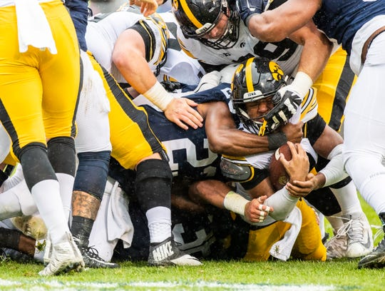 Ivory Kelly-Martin #21 of the Iowa Hawkeyes is tackled by Ayron Monroe #23 of the Penn State Nittany Lions at of Beaver Stadium on Saturday, October 27, 2018, in State College, Pennsylvania.outside of Beaver Stadium on Saturday, October 27, 2018, in State College, Pennsylvania.