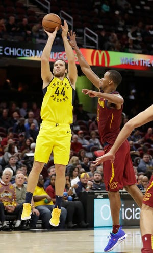 Indiana Pacers' Bojan Bogdanovic (44) shoots over Cleveland Cavaliers' Rodney Hood on Saturday night. The Pacers won 119-107.
