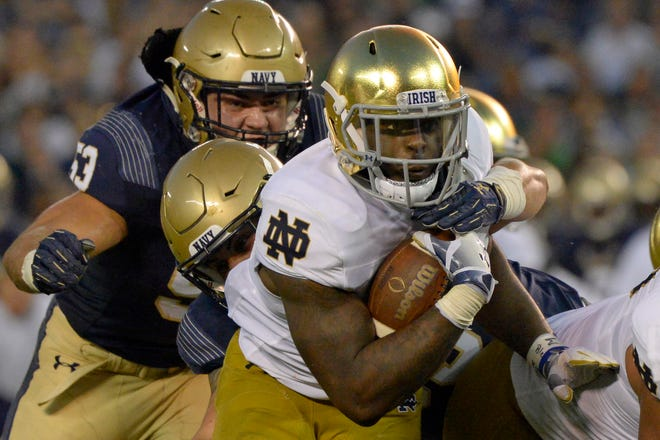 Oct 27, 2018; San Diego, CA, USA; Notre Dame Fighting Irish running back Dexter Williams (middle) runs for a touchdown during the second quarter against the Navy Midshipmen at SDCCU Stadium. Mandatory Credit: Jake Roth-USA TODAY Sports