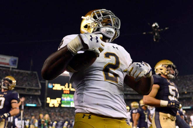 Notre Dame Fighting Irish running back Dexter Williams (2) celebrates after scoring a second quarter touchdown against the Navy Midshipmen at SDCCU Stadium on Oct. 27.