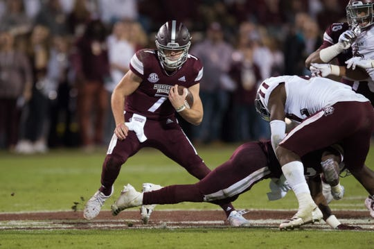 MississippI State QB Nick Fitzgerald runs for a gain in an NCAA college football game Saturday, Oct. 27, 2018, in Starkville,MS between Texas A&M and Mississippi State.