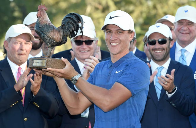 Cameron Champ hoists the tournament trophy, Reveille, after carding a 21 under par score to win his first PGA event on Sunday, October 28, 2018, in the final round of the Sanderson Farms Championship at the Country Club of Jackson in Jackson, Miss.