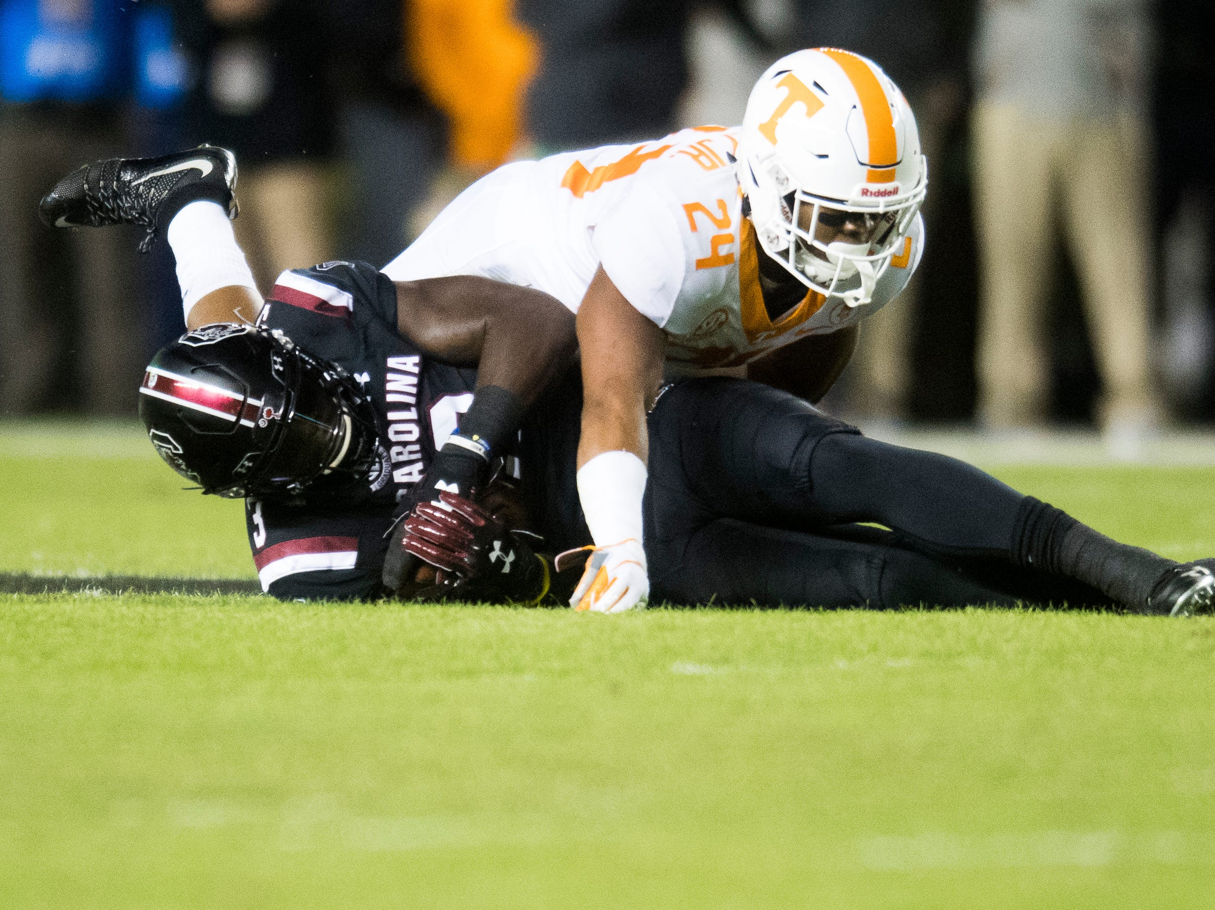Tennessee defensive back Todd Kelly Jr. (24) takes down South Carolina tight end K.C. Crosby (3) during a game between Tennessee and South Carolina at Williams-Brice Stadium in Columbia, South Carolina on Saturday, October 27, 2018.