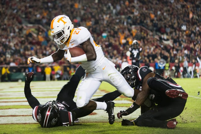 Tennessee defensive back Carlin Fils-aime (27) scores a touchdown past South Carolina placekicker Shane Hynes (12) and South Carolina linebacker T.J. Brunson (6) during a game between Tennessee and South Carolina at Williams-Brice Stadium in Columbia, South Carolina on Saturday, October 27, 2018.