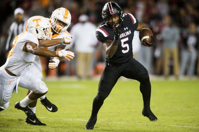 South Carolina running back Rico Dowdle (5) rushed for 140 yards against Tennessee.