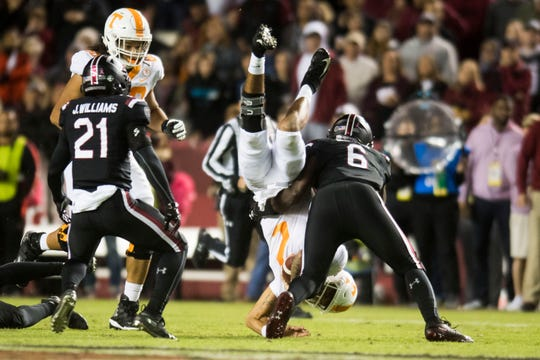 Tennessee quarterback Jarrett Guarantano (2) flips upside down while being tackled during a game between Tennessee and South Carolina at Williams-Brice Stadium Saturday, Oct. 27, 2018.