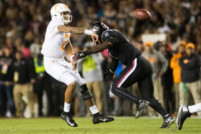 Tennessee quarterback Jarrett Guarantano (2) throws the ball as South Carolina linebacker Bryson Allen-Williams (4) goes for a tackle during a game between Tennessee and South Carolina at Williams-Brice Stadium in Columbia, South Carolina on Saturday, October 27, 2018.