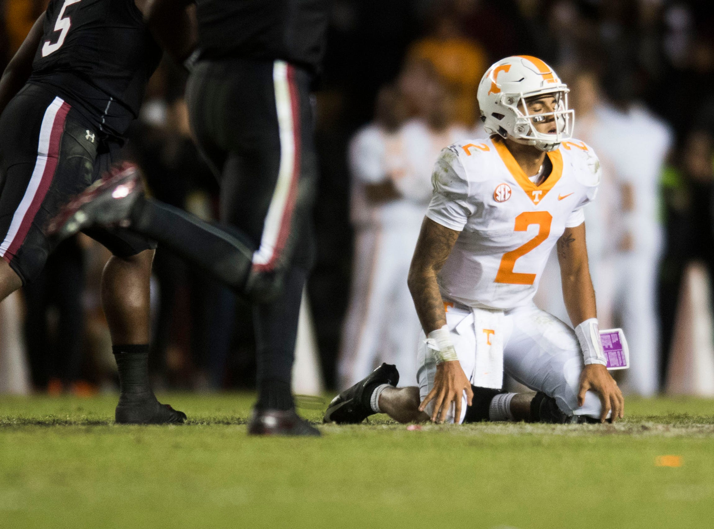 Tennessee quarterback Jarrett Guarantano (2) sits on the ground after being sacked on the fourth down at the end of a game between Tennessee and South Carolina at Williams-Brice Stadium Saturday, Oct. 27, 2018. South Carolina defeated Tennessee 27-24.