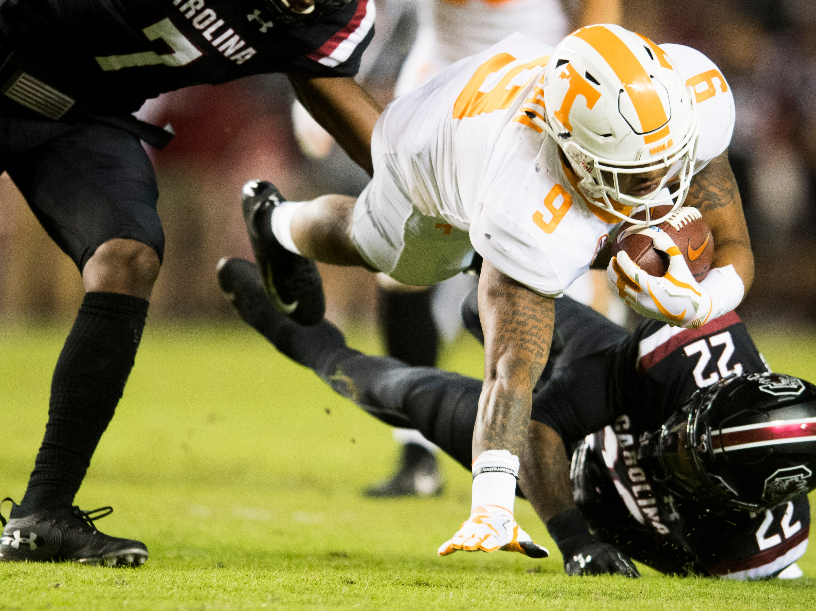 Tennessee running back Tim Jordan (9) leaps over South Carolina defensive back Steven Montac (22) for extra yardage during a game between Tennessee and South Carolina at Williams-Brice Stadium in Columbia, South Carolina on Saturday, October 27, 2018.