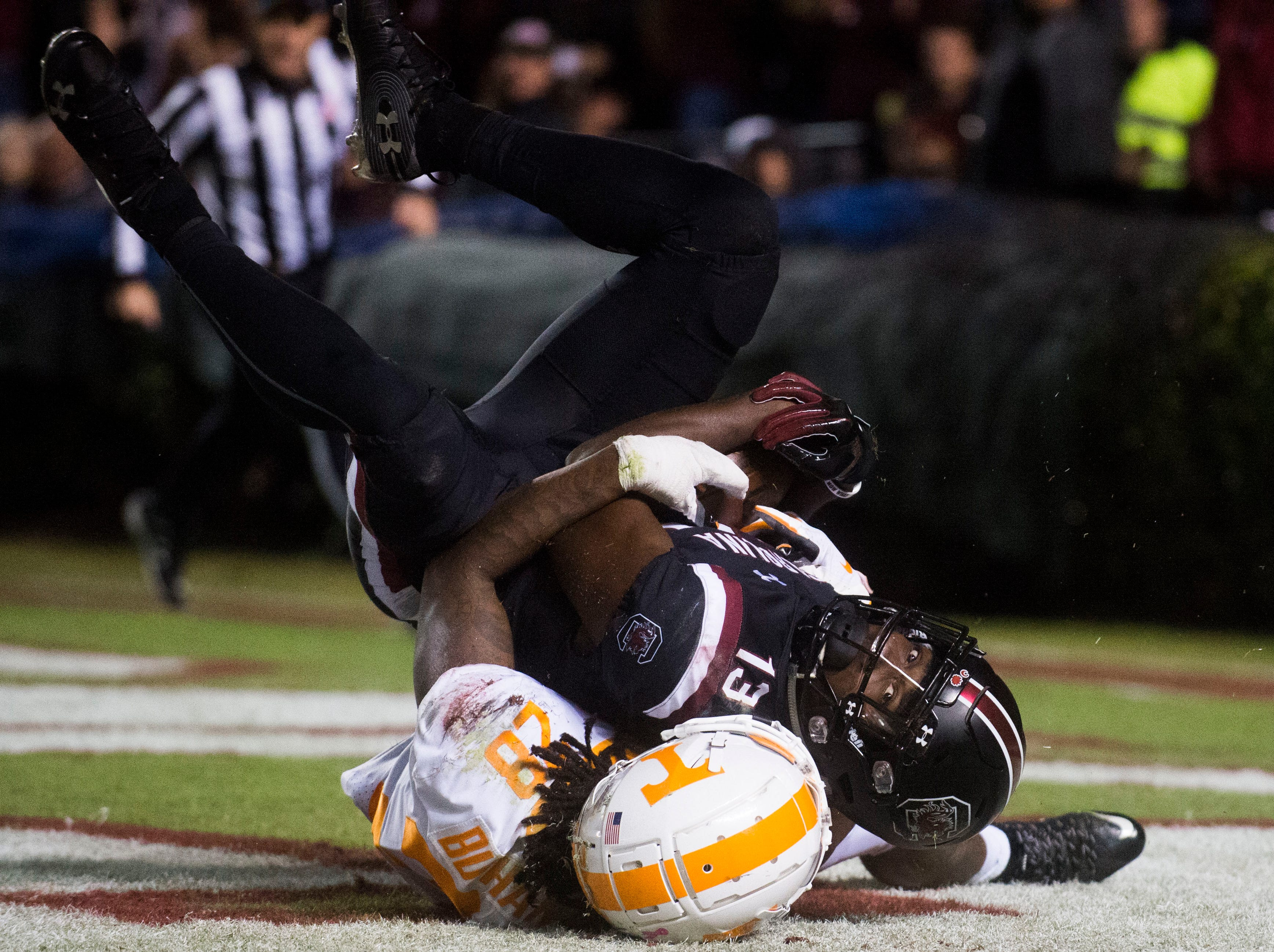 Tennessee defensive back Baylen Buchanan (28) takes down South Carolina wide receiver Shi Smith (13) in the end zone, and causes him to fumble the ball, during a game between Tennessee and South Carolina at Williams-Brice Stadium Saturday, Oct. 27, 2018. South Carolina defeated Tennessee 27-24.
