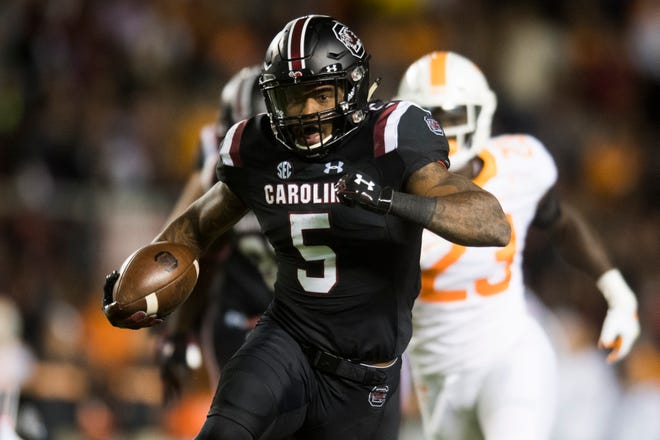 South Carolina running back Rico Dowdle (5) runs with the ball down the field during a game between Tennessee and South Carolina at Williams-Brice Stadium in Columbia, South Carolina on Saturday, October 27, 2018.