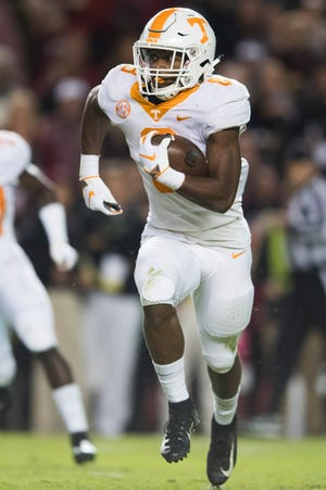 Tennessee running back Ty Chandler (8) runs with the ball down the field during a game between Tennessee and South Carolina at Williams-Brice Stadium in Columbia, South Carolina on Saturday, October 27, 2018.