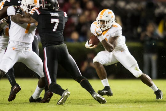 Tennessee running back Ty Chandler (8) runs the ball during a game between Tennessee and South Carolina at Williams-Brice Stadium Saturday, Oct. 27, 2018.