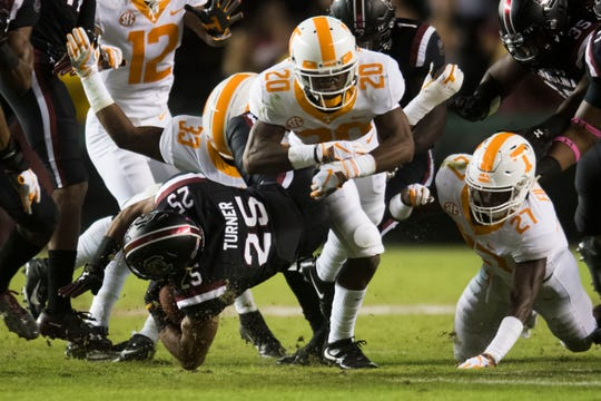 Tennessee players take down South Carolina running back A.J. Turner (25) during a game between Tennessee and South Carolina at Williams-Brice Stadium Saturday, Oct. 27, 2018.