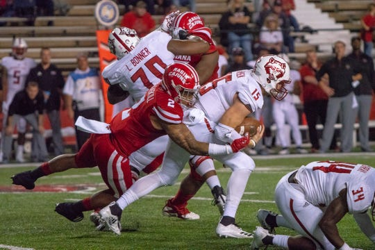 Linebacker Lorenzo McCaskill (2) brings down quarterback Justice Hansen in UL's win over Arkansas State last season at Cajun Field.