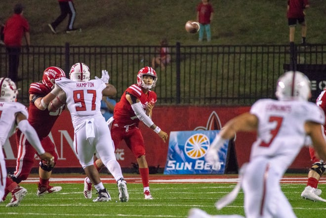 UL quarterback Andre Nunez throws a pass during the play as the Ragin' Cajuns take on the Arkansas State Red Wolves at Cajun Field on Oct. 27, 2018.