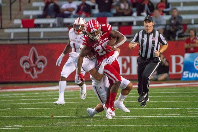 UL's Jarrod Jackson sprints for extra yardage during the Cajuns' 47-43 win over Arkansas State on Saturday at Cajun Field.