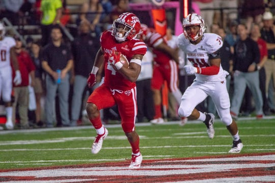 UL's Raymond Calais Jr. runs for some of his 121 yards in Saturday's win over Arkansas State.