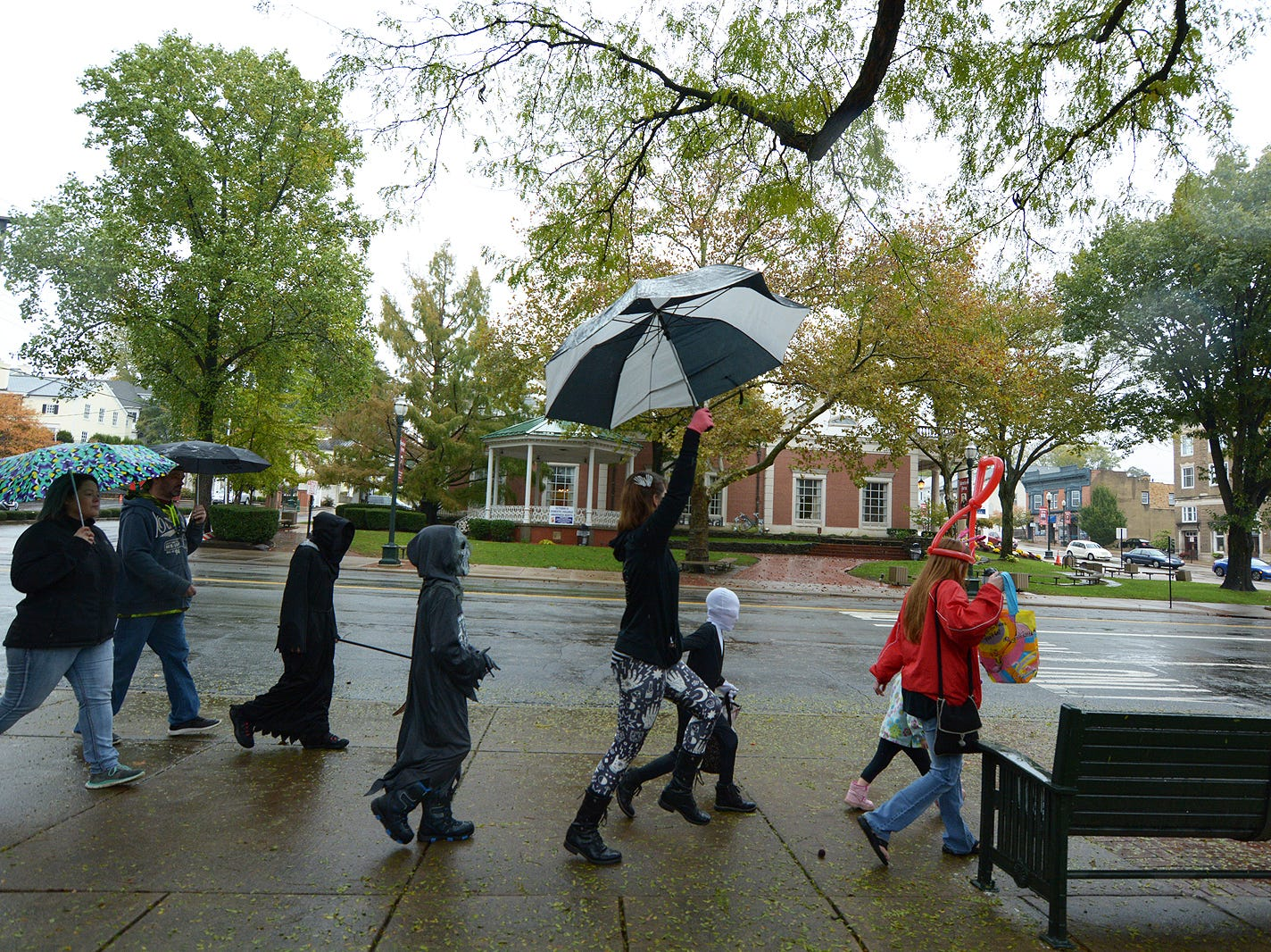 People march in the rain Saturday, Oct. 27, 2018, during the Lancaster Halloween Parade in downtown Lancaster.