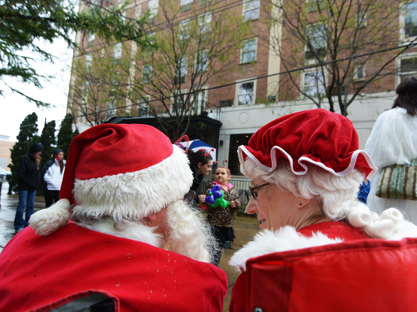 Santa and Mrs. Claus sit and judge the best costumes for the Lancaster Halloween Parade Saturday, Oct. 27, 2018, in downtown Lancaster.