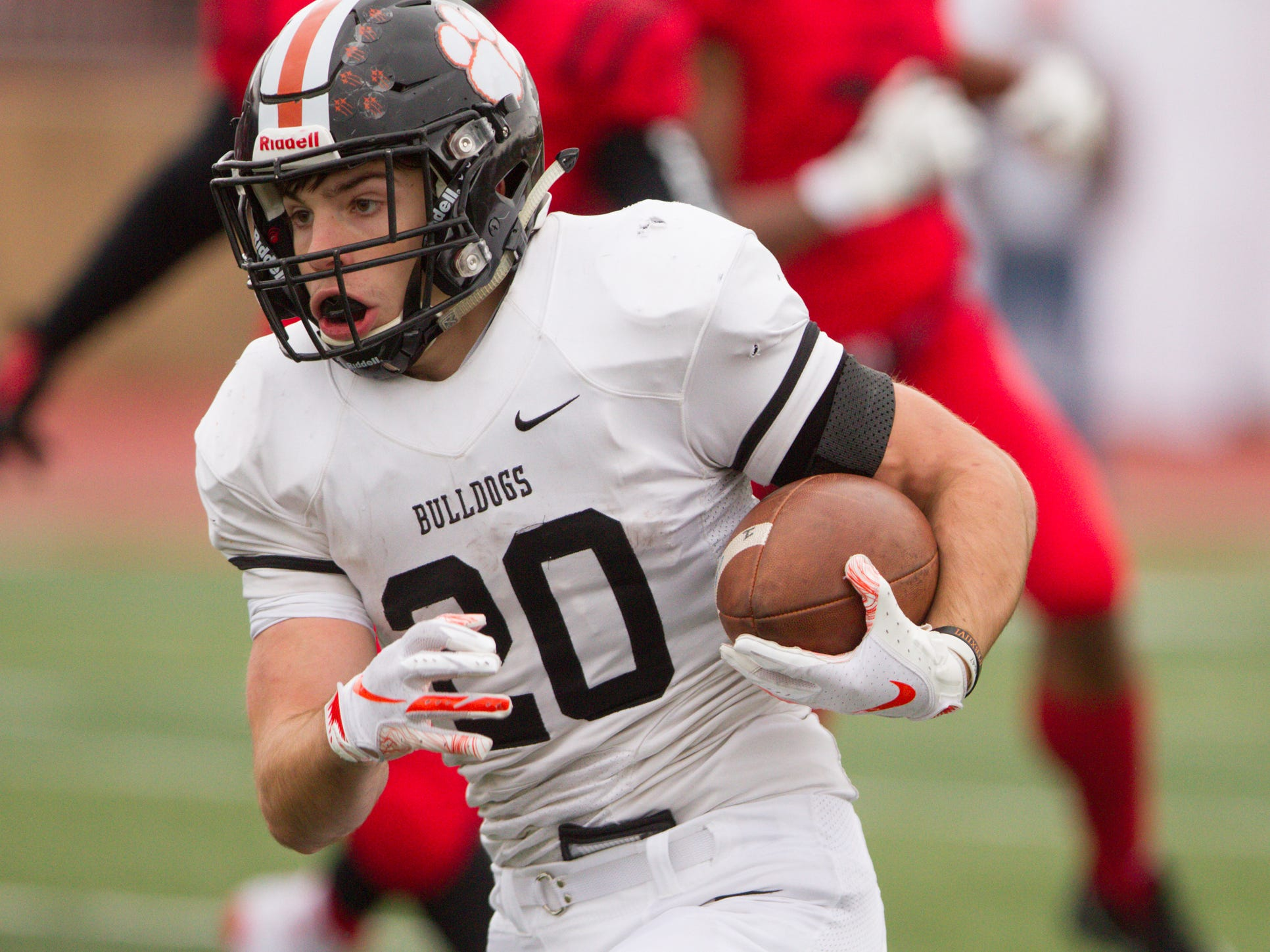 Brighton's Chris Seguin carries the ball in the playoff game against East Kentwood Saturday, Oct. 27, 2018.